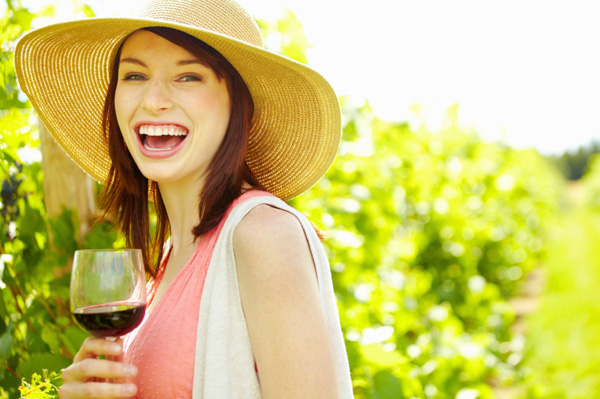 Happy woman drinking wine