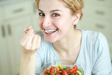 Woman eating energy boosting salad