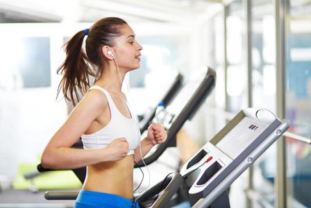 Happy woman on treadmill