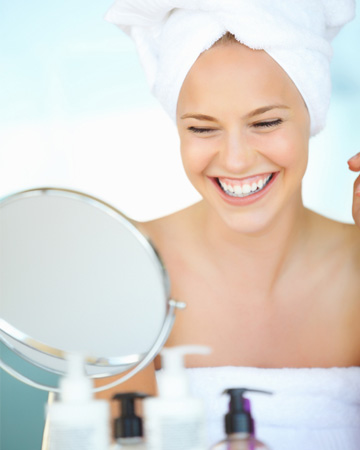 Happy woman with cosmetics