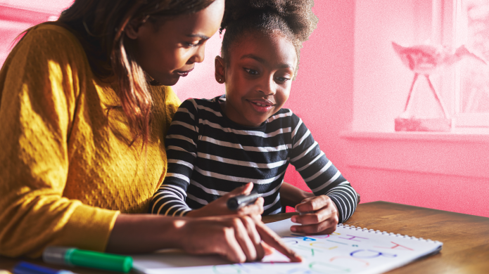 Black Mom Helping Young Daughter Learn