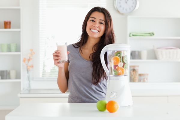 Healthy woman making smoothie