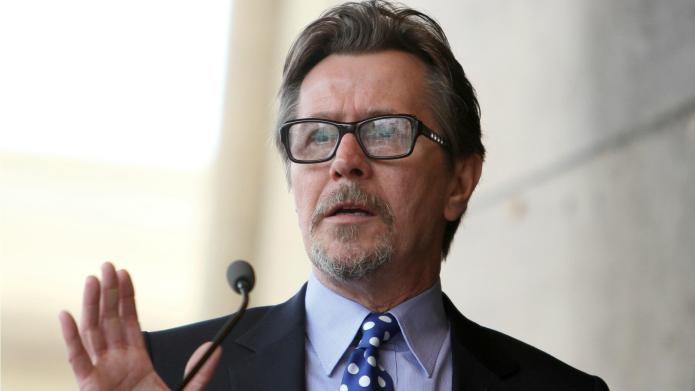 Gary Oldman offers token apology on