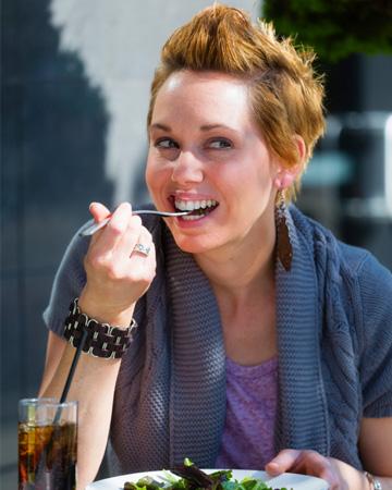 Hip woman eating salad