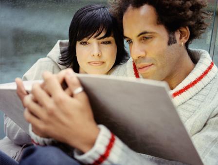 Couple reading photo book