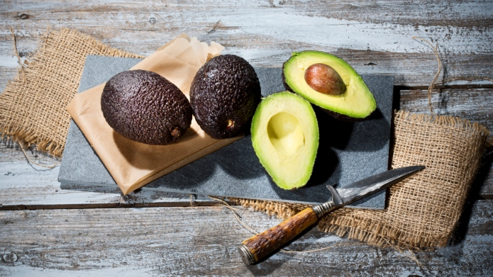 Sliced and whole avocados (Persea americana),