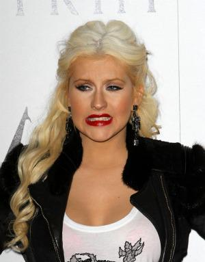 Christina Aguilera is not pregnant, just