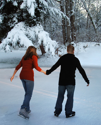 Couple ice skating together.