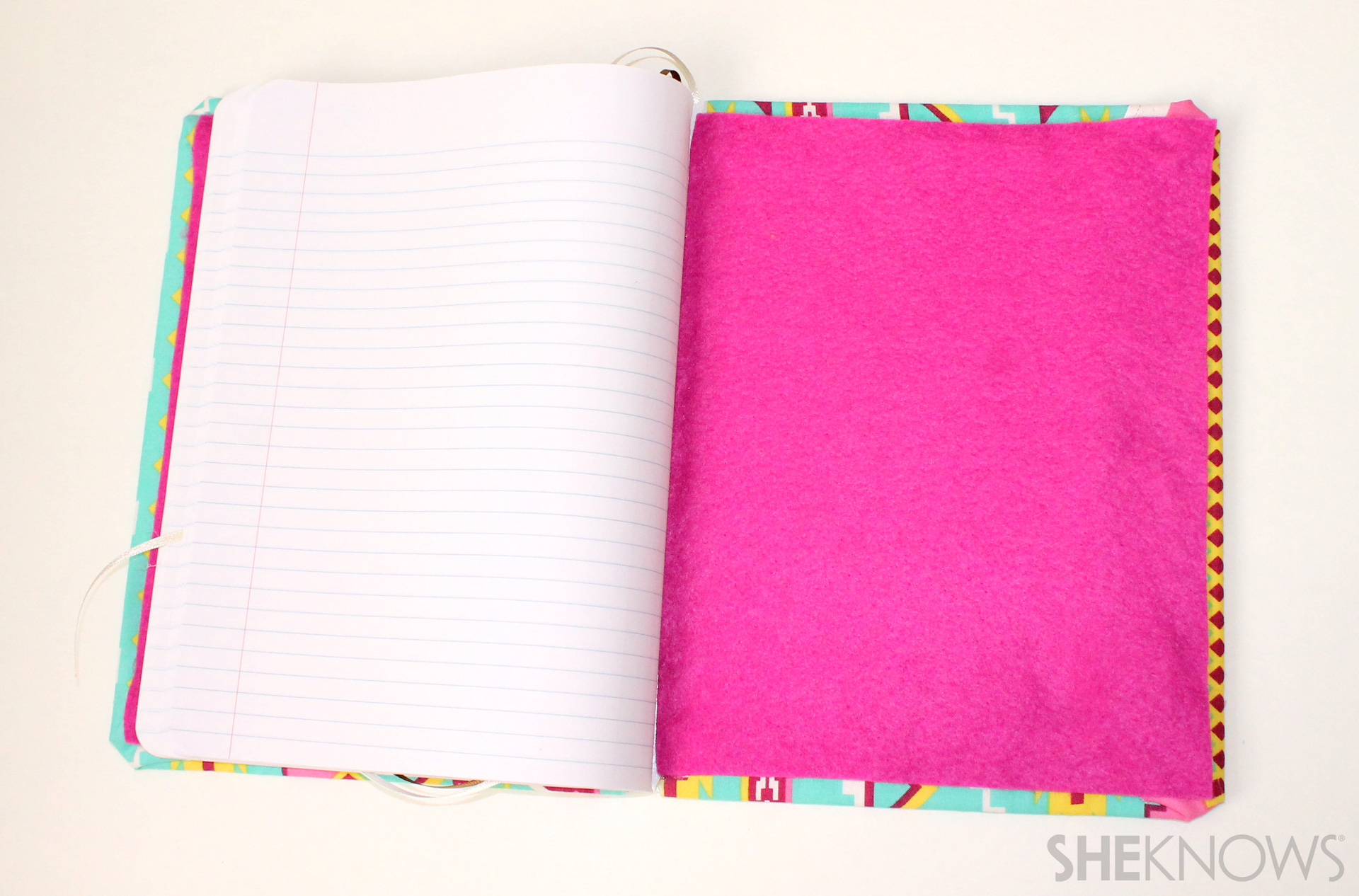 fabric covered composition book: Glue the felt into place inside the front and back covers
