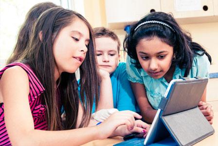 Kids using iPad in school