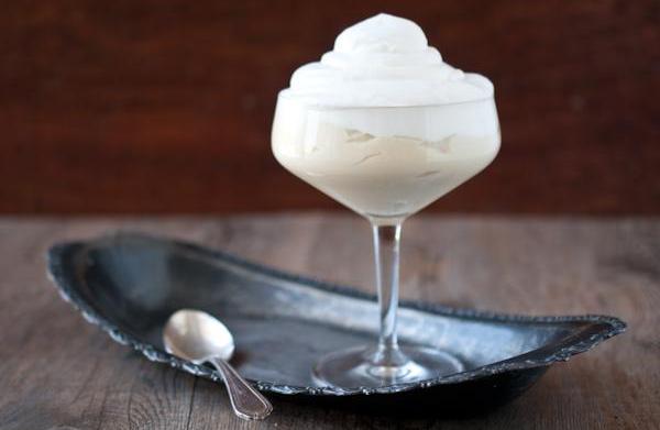 Homemade lemon pudding with vanilla whipped