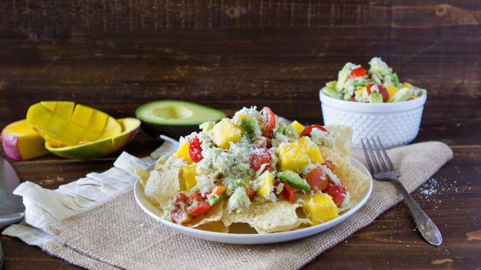 Summer-ready crab, avocado and mango nachos