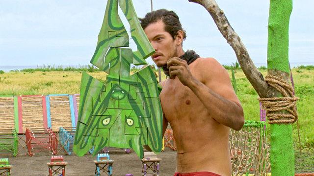 Jay Starrett works on puzzle during Survivor: Millennials Vs. Gen-X