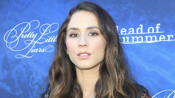 Troian Bellisario says she's staying out