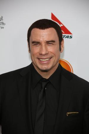 John Travolta at a benefit