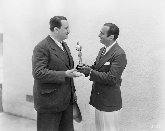 Douglas Fairbanks, Sr. presents the 1929 Oscar for Title Writing to Joseph Farnham