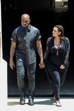 Kanye and Kim walking together in Beverly Hills
