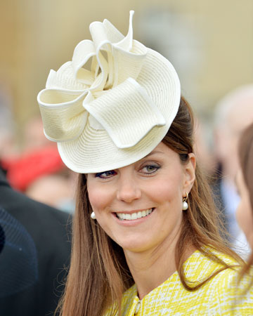 Kate wearing a white hat