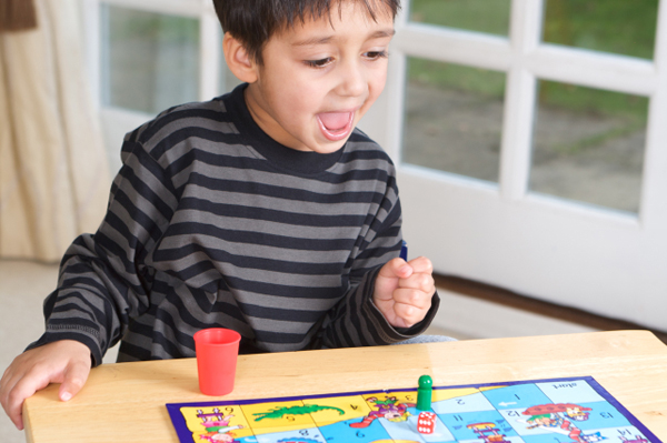 Kids playing snakes and ladder