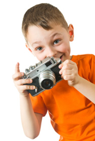 Smiling kid with camera