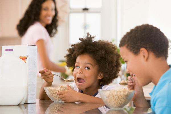 Kids eating cereal in the morning