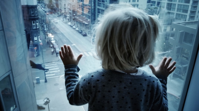 Child looking at street from above.