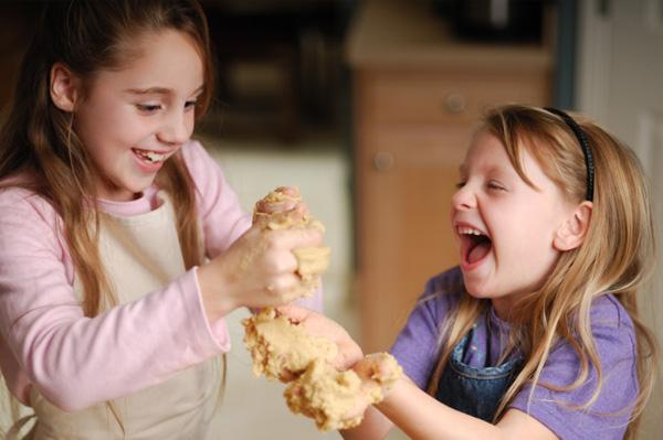 Kids making peanut butter playdough