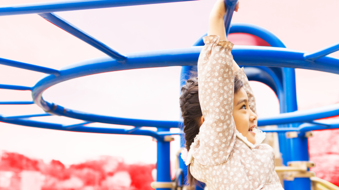 Girl Playing on Playground Jungle Gym