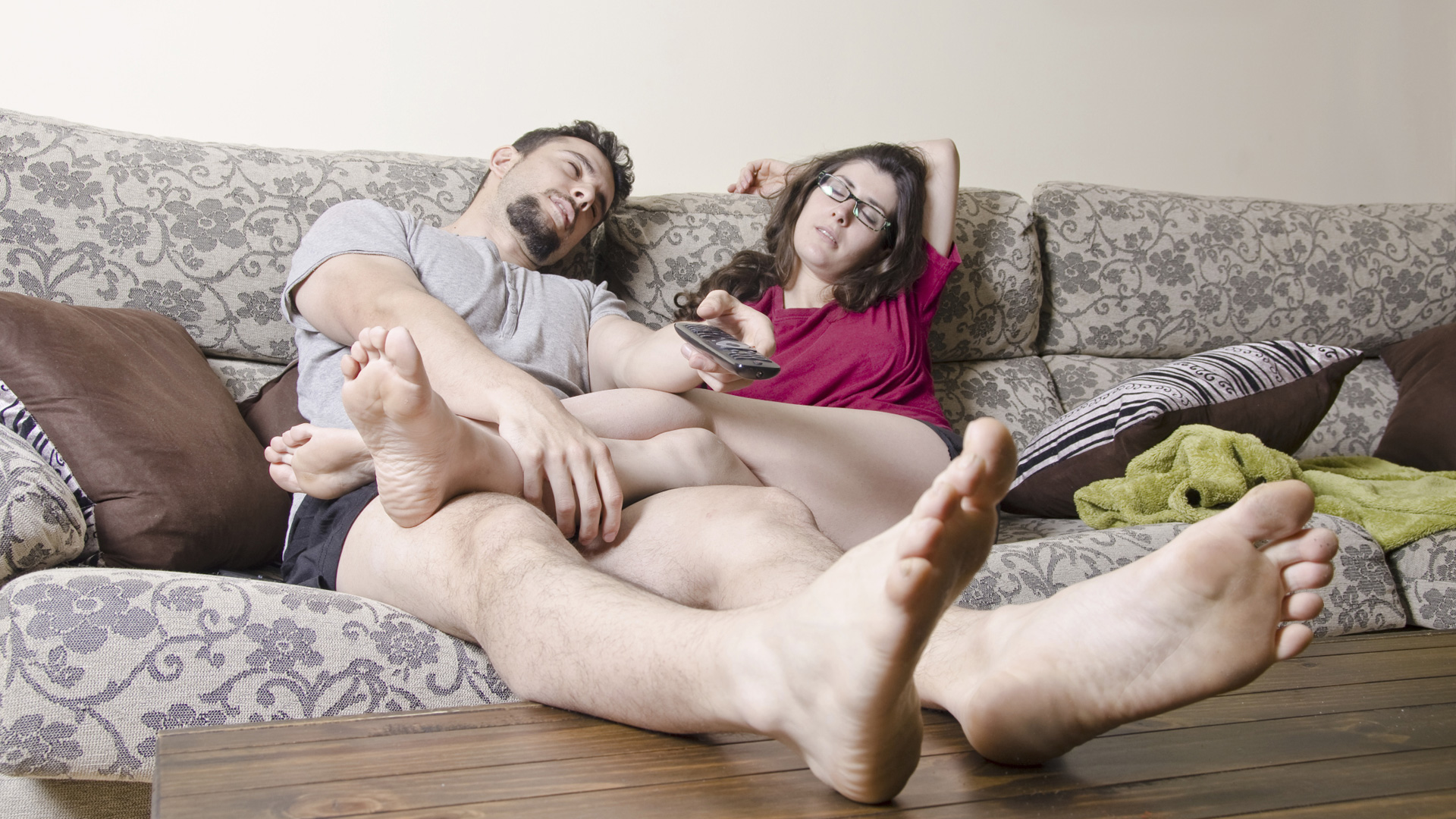 Lazy couple on couch