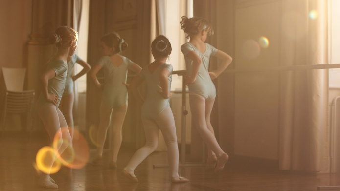 Girls dancing ballet in beautiful sunlight