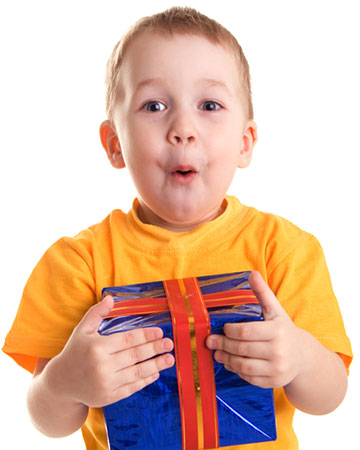 Excited Boy with a birthday gift | Sheknows.com.au