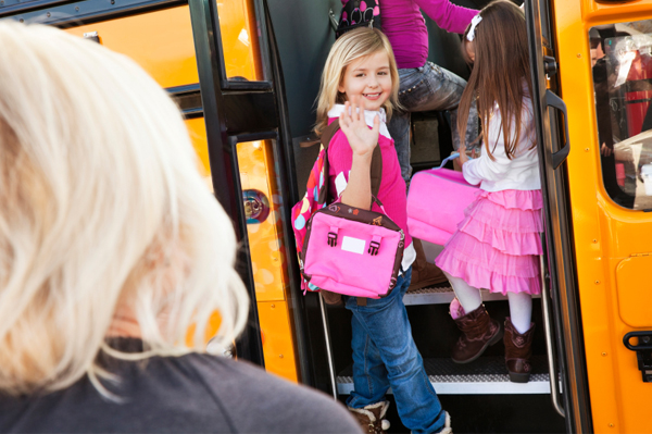 Little girl boarding schoolbus
