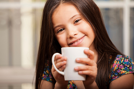 Little girl drinking coffee | Sheknows.com