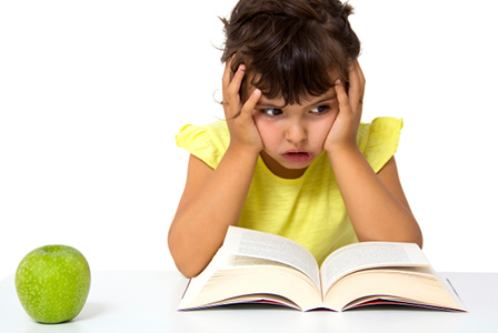 Little girl frustrated with book   Sheknows.com