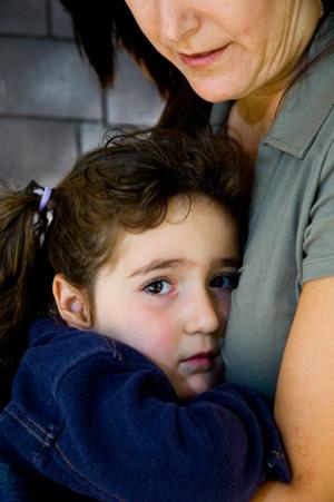 Little Girl Holding onto Mother