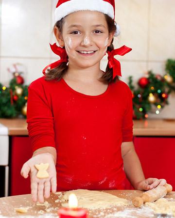 little girl making christmas ornaments