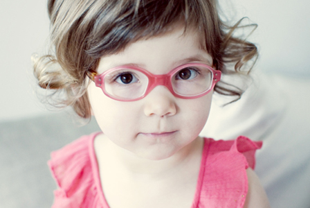 Little girl wearing glasses | Sheknows.com