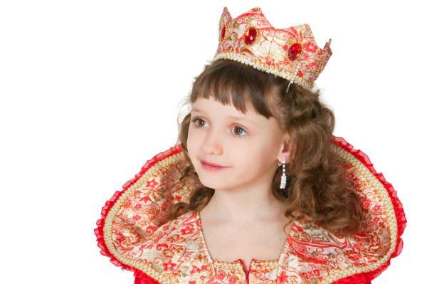 Little girl dressed up as a queen