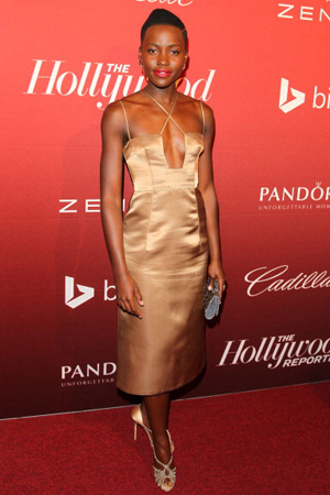 Lupita Nyong'o wearing a gold dress