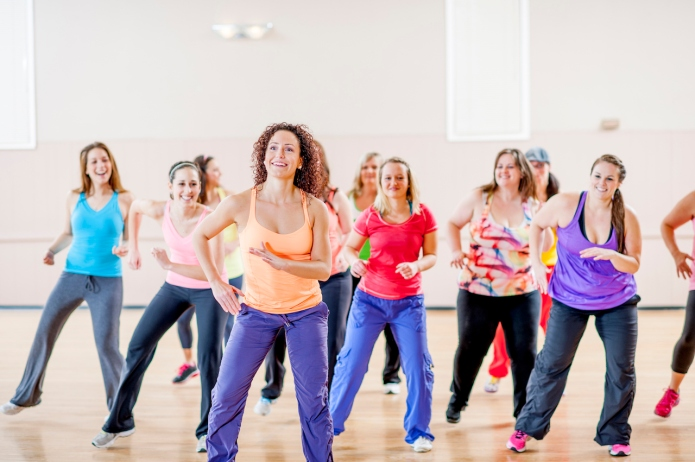 Woman dancing together during an aerobic