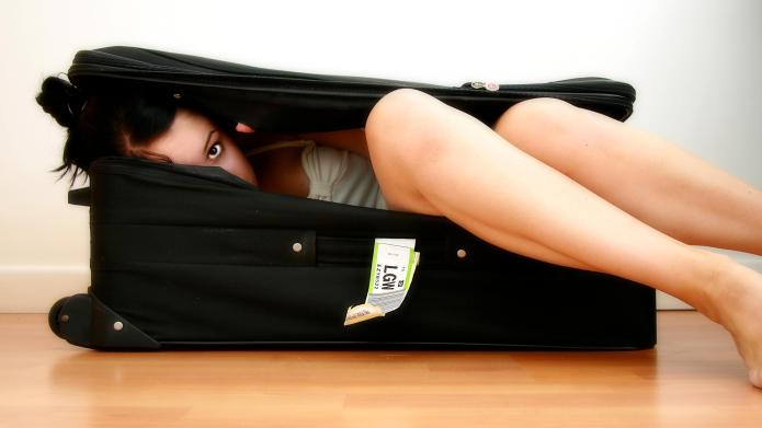 Girl Peers Out From Inside Suitcase