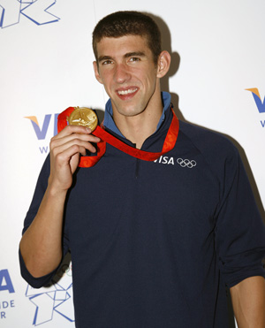 Michael Phelps with Olympic medal