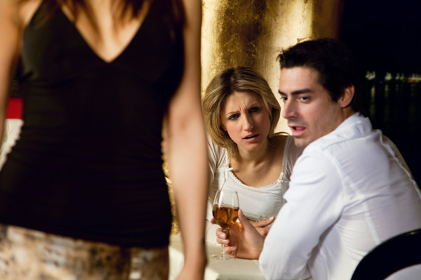 Man checking out other woman