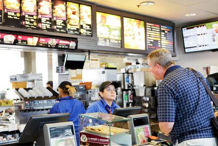 Man ordering at McDonalds