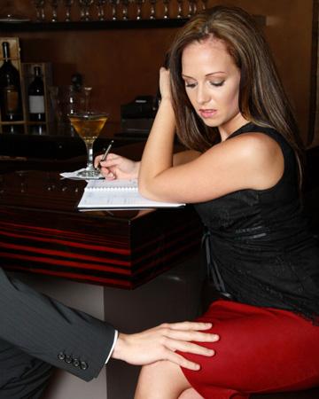 Man touching woman's leg