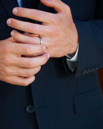 Man's hands with wedding band
