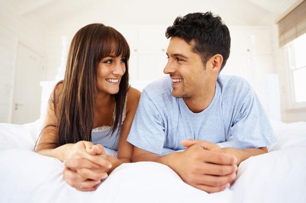Newly married couple on new mattress