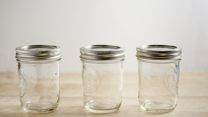 Empty canning jars on a wooden