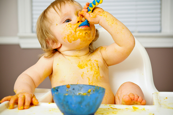 Messy baby eating a meal | Sheknows.com