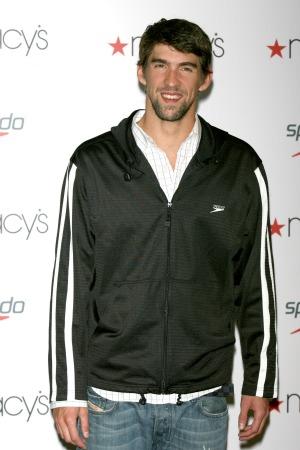 Michael Phelps celebrates his retirement